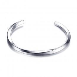 Elegancka biżuteria damska męska minimalistyczna bransoletka w formie lekko geometrycznej obręczy w srebrnym kolorze